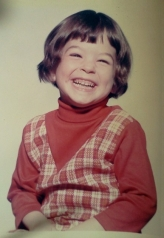 Maggie as a small child, smiling
